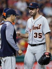 Tigers pitcher Justin Verlander leaves the baseball game after giving the ball to manager Brad Ausmus, left, during the seventh inning of the Tigers' 4-0 loss Saturday in Cleveland.