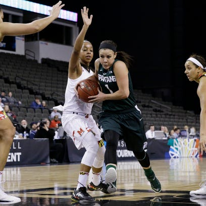 Michigan State guard Aerial Powers, left, shoots against Maryland guard Brene Moseley, center, and center Malina Howard during the first half of their Big Ten tournament quarterfinal Friday in Hoffman Estates, Ill. Powers, a sophomore, finished with 26 points and 10 rebounds.