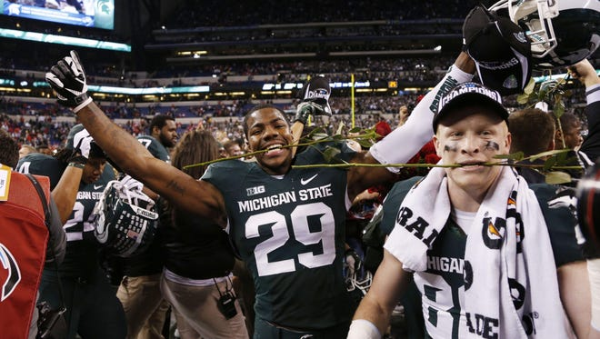 Dec 7, 2013; Indianapolis, IN, USA; Michigan State Spartans safety Mark Meyers (29) reacts to defeating the Ohio State Buckeyes in the Big 10 Championship game at Lucas Oil Stadium. Michigan State defeats Ohio State 34-24.  Mandatory Credit: Brian Spurlock-USA TODAY Sports