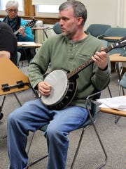 Gavin Barry of Rochester practices his banjo picking in the Melody on Frets workshop.