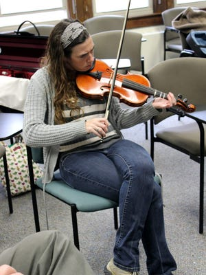 Erica King, from Warsaw (Wyoming County) takes part in the beginner fiddle workshop at the 14th Annual Irish Cultural Day, sponsored by the Tom Finucane Branch of Comhaltas Ceoltoiri Eireann.
