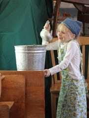 First-grader Kate Mosher demonstrates how schoolchildren