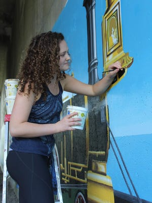 Emily Waldman has been working on her train mural for three years, and hopes to finish it later this summer. It's located 3/8 of a mile north of Main Street, Fishers, on the Auburn Trail.
