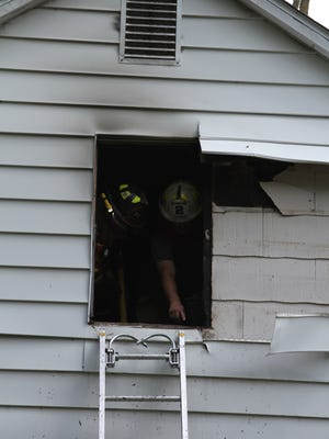 Howell firefighters put out a second floor bedroom fire Tuesday afternoon on Highland Road.