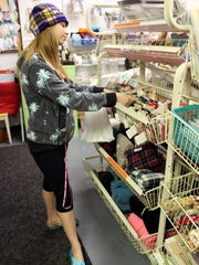 Ashley Klatt of Palmyra shops at Craft Bits & Pieces in Fairport's Village Landing.