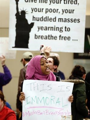 Nicole, who didn't want to give her last name, protests against President Donald Trump's executive order barring muslims from certain middle eastern countries from entering the United States at DFW airport, Saturday, Jan. 28, 2017.