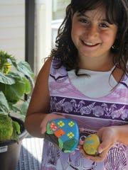 Julianna Passalacqua, 7, of Sweden, with a rock she