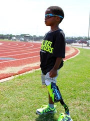 Kenbe Rogers, 8, poses for a portrait. Rogers plays