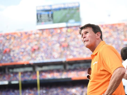 Tennessee athletics director Dave Hart watches the scoreboard during the first half against Florida at Ben Hill Griffin Stadium in Gainesville, Fla., on Saturday, Sept. 26, 2015.