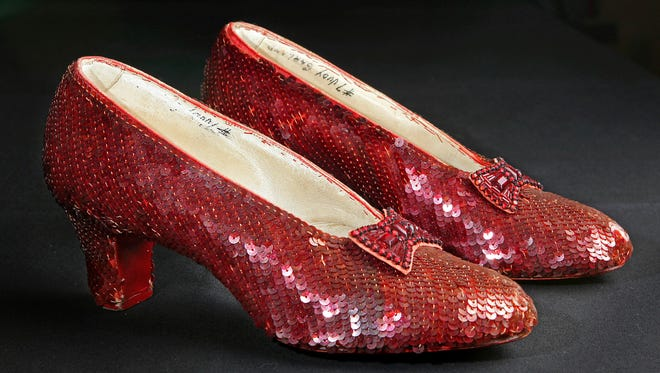 """The sequin-covered ruby slippers worn by Judy Garland in """"The Wizard of Oz""""  at the offices of Profiles in History in Calabasas, Calif."""