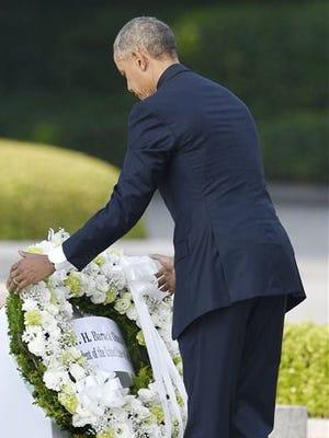 President Barack Obama lays a wreath at Hiroshima Peace Memorial Park on Friday.