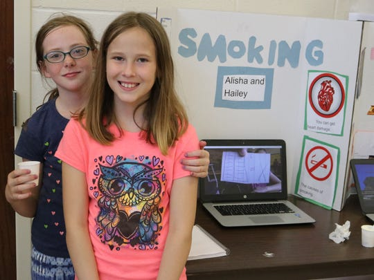 """Fourth-grade Bataan students Alisha Allen and Hailey Pedigo did their """"Genius Hour"""" project on the dangers of smoking and getting the word out to others."""