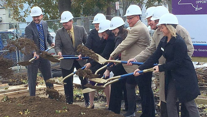 State and local officials gather Thursday for a groundbreaking on a new Elmira affordable housing project.
