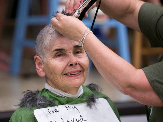 Sally Debono has her hair shaved off for her grandson Jack Klein, at Jack Klein day, an event raising money for childhood cancer to honor Klein, a local boy who died in from the disease, Indianapolis, Saturday, June 2, 2018. The head-shaving event is coupled with St. Baldrick's Foundation.