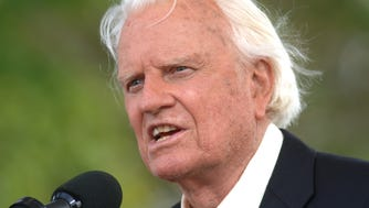 The Rev. Billy Graham speaks on stage on the third and last day of his farewell American revival in the Queens borough of New York Sunday, June 26, 2005.