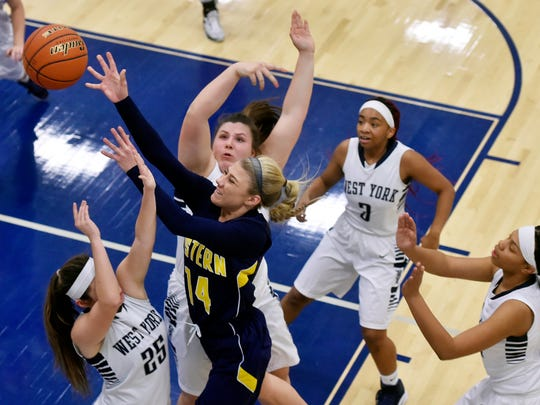 Eastern York's Hannah Myers shoots against West York's Emma Tyndall and Paige Weekly in the second half of a YAIAA girls' basketball game Friday, Jan. 6, 2017, at West York. Eastern York defeated West York 55-49.