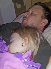 Dezirae Sheldon snuggles with her father, Willis Sheldon.
