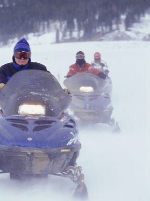 Select snowmobile trails will open this week after a snowfall.