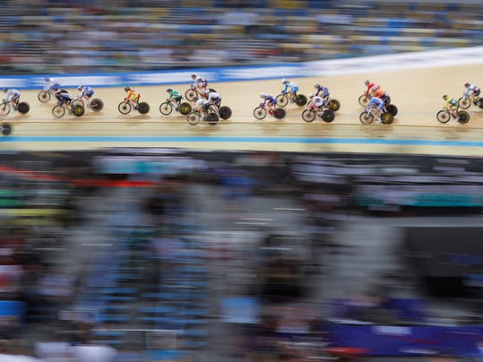 Track cyclists compete in the women's scratch race at the World Track Cycling Championships in Hong Kong, Wednesday, April 12, 2017. (AP Photo/Kin Cheung)