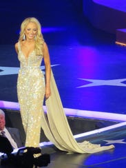 Davis is all poise and charm in the evening gown portion