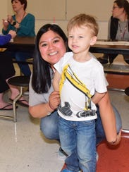 Kayla Bowker and son Eli Russell, 4, spend his fourth