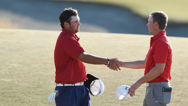 Patrick Reed (left) shakes hands with Jordan Spieth (right) after completing the third round of the 2015 U.S. Open golf tournament at Chambers Bay.