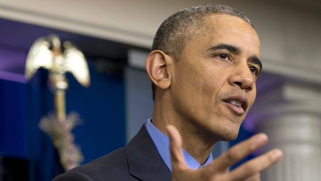 President Barack Obama speaks during a news conference in the briefing room at the White House in Washington.
