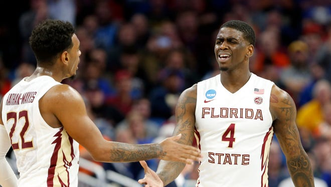 Florida State guard Dwayne Bacon (4) reacts during the first half against the Florida Gulf Coast Eagles in the first round of the NCAA Tournament at Amway Center.