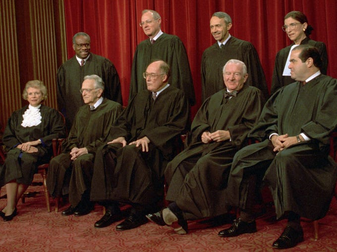 Members of the Supreme Court pose for their portrait