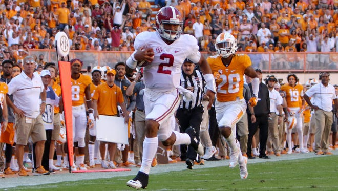 Alabama Crimson Tide quarterback Jalen Hurts (2) runs the ball against the Tennessee Volunteers during the first half at Neyland Stadium.