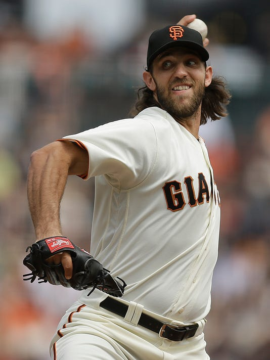 FILE - In this Sept. 3, 2017 file photo, San Francisco Giants pitcher Madison Bumgarner works against the St. Louis Cardinals in the first inning of a baseball game in San Francisco. Bumgarner is in the best shape of his life ready for a bounce-back season after a most forgettable one for San Francisco's big lefty ace. (AP Photo/Ben Margot, file)
