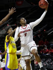 Jasmin Thomas goes in for a shot in the first half of UL's  game with Southern University New Orleans on Saturday in the Cajundome. UL won the game 87-57.