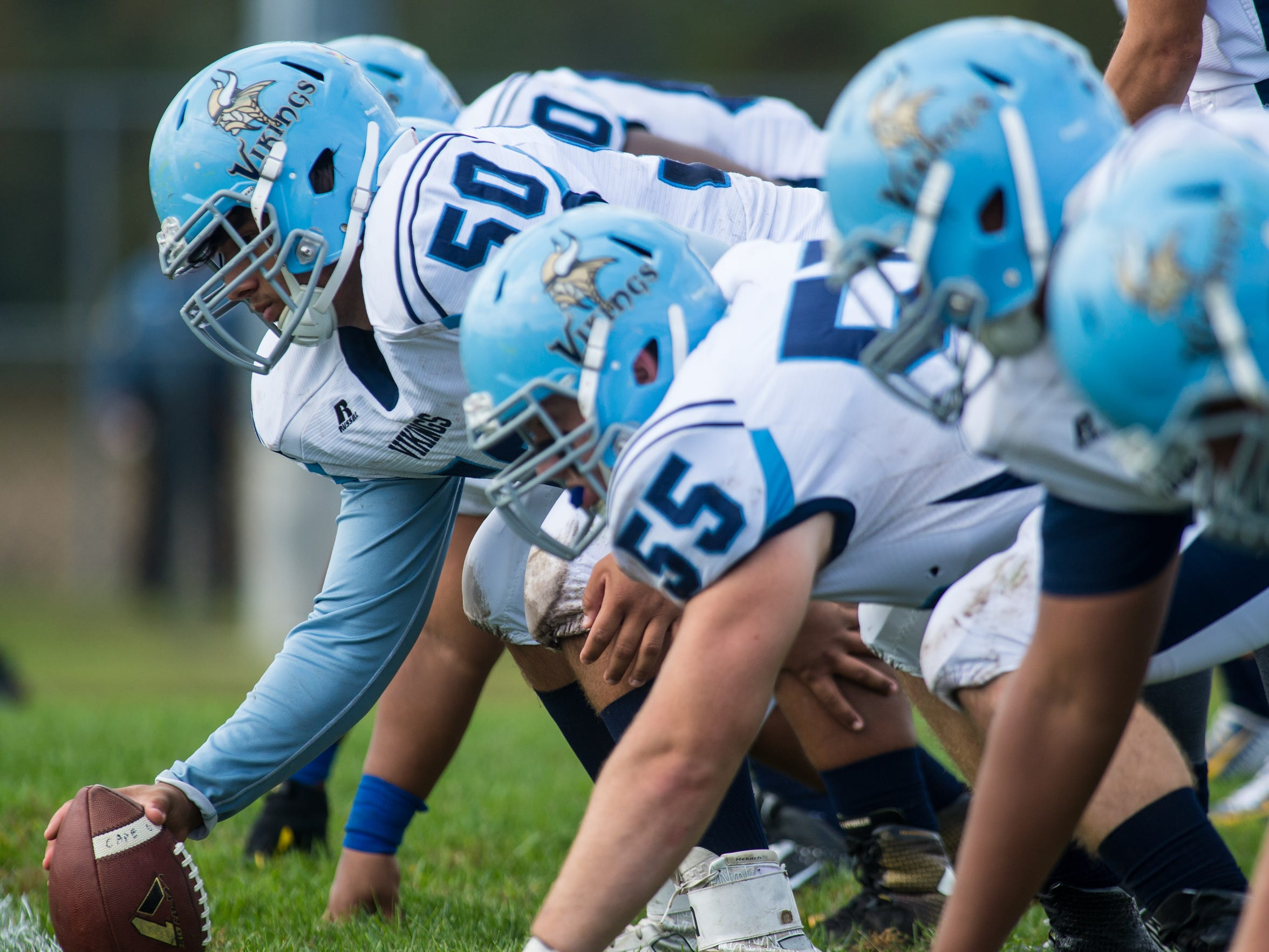 Cape Henlopen center Julian Medina (50) leads out the Viking offense against Sussex Central in Georgetown on Oct. 10, 2015.