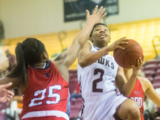 UMES guard Ciani Byrom (2) drives to the basket against Howard on Monday, Feb 1 at the William P. Hytche Athletic Center in Princess Anne.