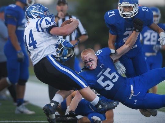 Sioux Falls Christian's Joel DeHaai losses his helmet as he tackles Canton's Sam Hopper out of bounds Friday during the game at Bob Young Stadium.