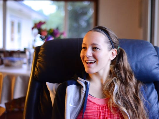 Esther Suelzle, a recent Cascade High School graduate who is battling cancer, is photographed at her home in Aumsville on Thursday, Oct. 30, 2014.