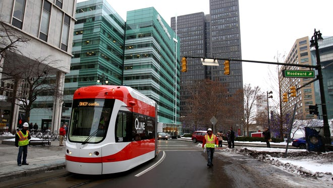 A QLine streetcar makes its way on Woodward Avenue through Campus Martius in Detroit on Tuesday, December 13, 2016.