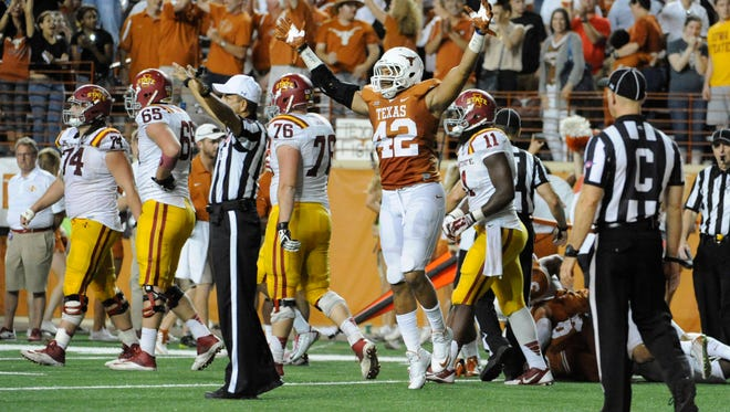 Texas Longhorns defensive end Caleb Blueitt (42) reacts after defeating the Iowa State Cyclones at Darrell K Royal-Texas Memorial Stadium. Texas beat Iowa State 48-45.