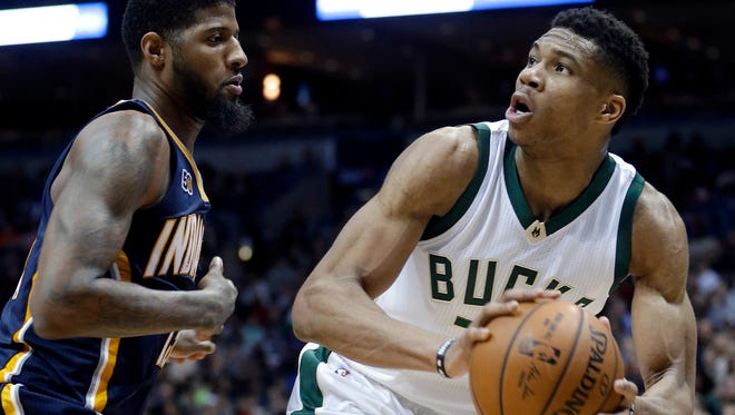 Giannis Antetokounmpo looks to shoot against Indiana Pacers' Paul George.
