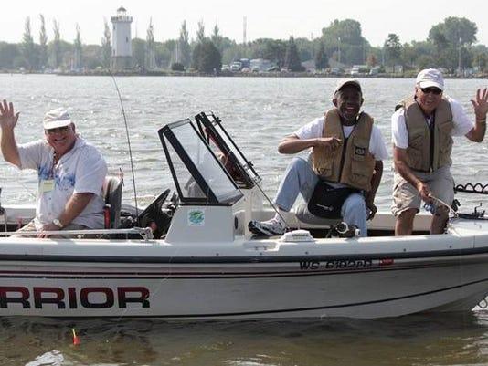 Fishing no Boundaries boat with wavers.JPG