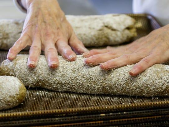Baker Terri Schuldt prepares Artisan Rye bread at StoneBank