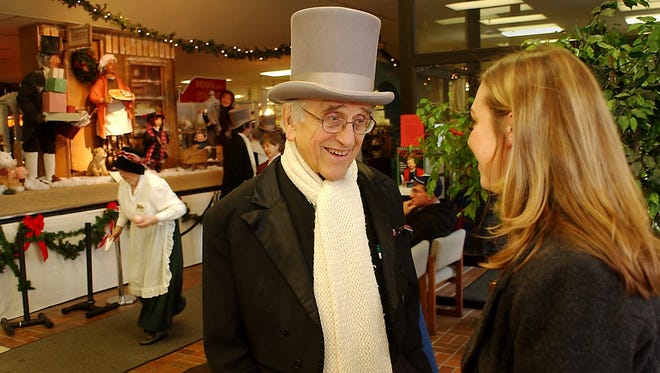 In this 2004 photo, Homer Marple talks with his great-niece Erin Marple after she did some shopping at what was then known as the Craft Antique Co-op in Greece. Homer Marple was dressed in character for the Dickens Festival that's held there every year.