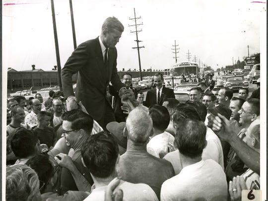 Presidential hopeful John F. Kennedy is greeted by Warner Gear workers in 1960.