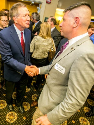 Ohio Gov. John Kasich (left) chats with Jonathan Lubecky, a student at The Citadel, before Kasich spoke to the South Carolina Republican House Caucus at the Hilton in Columbia, SC, Wednesday evening.