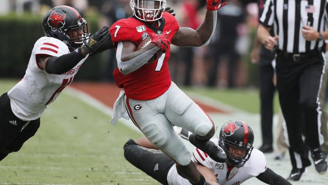Georgia running back D'Andre Swift turns the corner on a pass play which he broke for a touchdown