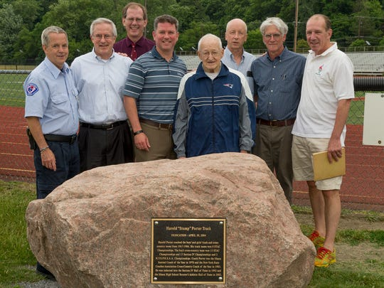 "Ithaca High School graduates and cross country team members meet with their coach,  Harold ""Stump"" Porter, center, to recognize the mounting of a plaque in honor of Porter's coaching succes. From left are Tim Bangs, David Stinson, Jamie Loehr, Ithaca High School Principal and former track and cross country coach Jason Trumble, Porter, Thomas Hartshorne, Steve Gibian and Mark Loehr."