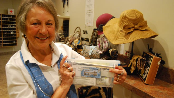 Mary Reese holds a chemotherapy relief kit. The China Township woman  will be selling purses on Nov. 3 at Immanuel Lutheran Church in St. Clair to fund the kits.