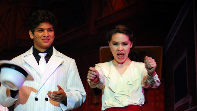 "Daniel Adendorff, left, and Sophia Brazda rehears a scene in Christian Youth Theatre's presentation of ""Guys & Dolls"" at UL's Angelle Hall."