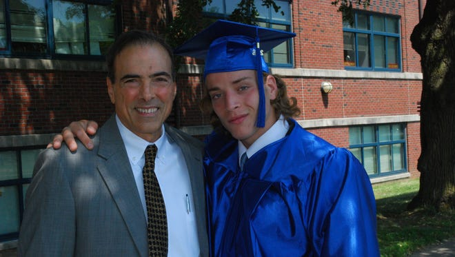 Lou Codella, a 40-year volunteer at The Children's Village in Dobbs Ferry, with a graduate of the program in June 2016.