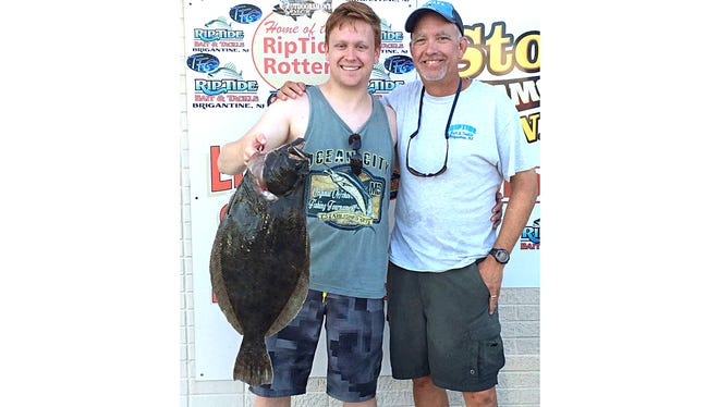 Andy and Alex Smith with a 7 pound flounder that measured 27.5 inches. They were using strips of kingfish.